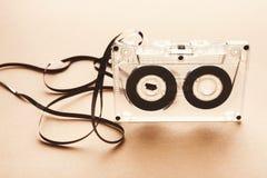 Винтажная магнитофонная кассета на коричневой предпосылке Стоковые Изображения