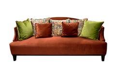 Винтажная оранжевая изолированная софа Стоковое Фото