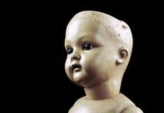 Винтажная сторона куклы изолированная на черноте Стоковая Фотография