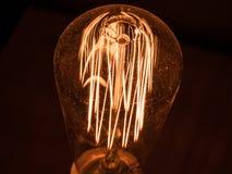 Винтажная электрическая лампочка стоковые изображения