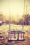 Винтажное стилизованное старое упущенное пустое качание Стоковая Фотография