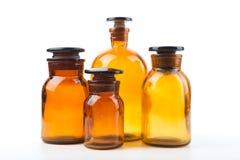 Винтажные бутылки фармации на белой предпосылке Стоковая Фотография