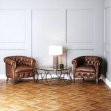 Винтажные кожаные кресла и стеклянный стол с лампой Стоковое фото RF