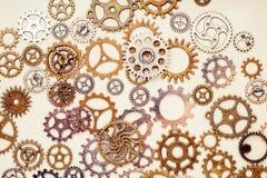 Винтажные колеса шестерни на светлой предпосылке Стоковое фото RF