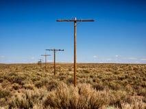 Винтажные рангоуты телефона сделанные от древесины на трассе 66 в Аризоне Стоковые Фото