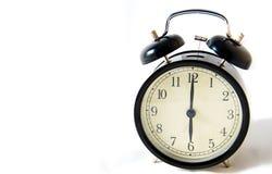 Винтажные черные часы на белой предпосылке Стоковая Фотография RF