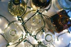 Винтажные ясные стеклянные бутылки ликера сверху с lig рождества Стоковая Фотография RF