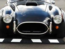 Винтажный автомобиль спорт черноты кобры Форда на винтажном Grand Prix стоковые фото
