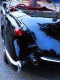 Винтажный автомобиль с откидным верхом Chevrolet Corvette от позади стоковые фотографии rf