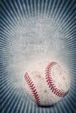 Винтажный бейсбол и голубая предпосылка Стоковая Фотография