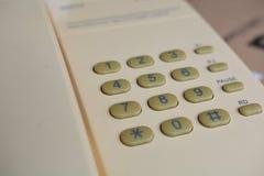 Винтажный желтый телефон Стоковые Фото