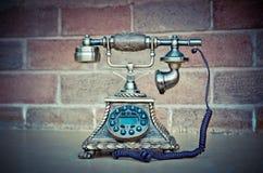 Винтажный изолят телефона на предпосылке кирпича Стоковое Изображение