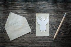 Винтажный карандаш ангела конвертной бумаги на черной доске Стоковое Изображение