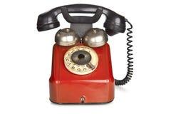 Винтажный красный телефон изолированный на белой предпосылке стоковое фото