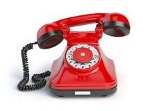 Винтажный красный телефон на белой предпосылке введенное в моду ретро Стоковое Изображение
