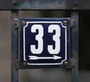 Винтажный номер дома металла на стене Стоковое Фото