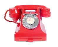 Винтажный роторный красный телефон стоковые изображения
