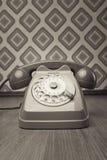 Винтажный телефон на обоях диаманта Стоковая Фотография RF