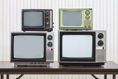4 винтажных телевидения Стоковая Фотография RF