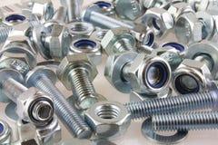 Винты и гайки крепежной детали металла механически Стоковое Изображение RF