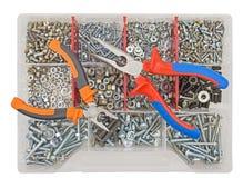 Винты и гайки плоскогубцев на фоне Стоковое Изображение