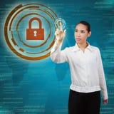 Виртуальный экран бизнес-леди касающий Стоковое фото RF