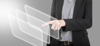 Виртуальный экран руки бизнес-леди касающий. Изолированный на белизне. стоковое фото rf