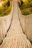 Вися пешеходный мост в Непале Стоковая Фотография RF