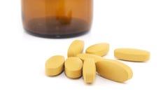витамин пилек микстуры c бутылки предпосылки Стоковое Изображение RF