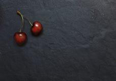 2 вишни на каменной предпосылке Стоковые Фотографии RF