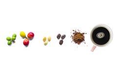 Вишни, фасоль и порошок кофе с чашкой на белой предпосылке Стоковые Фото