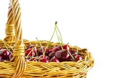 Вишни ягод в корзине на белой предпосылке Стоковая Фотография