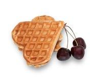 Вишня и waffle в форме изолированного сердца Стоковые Фото