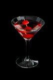 Вишня martini на черноте стоковая фотография rf