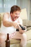 Видео- Gamer на кресле Стоковая Фотография