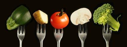 вилка изолированная над овощами белыми стоковое фото