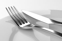 Вилка и нож с плитами иллюстрация штока