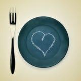 Вилка, плита и сердце Стоковое Фото