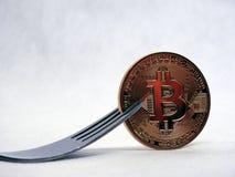 Вилка Bitcoin трудно-мягкая стоковое фото
