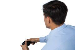 Вид сзади бизнесмена играя видеоигру Стоковые Изображения