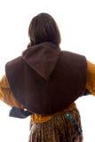 Вид сзади молодой женщины стоя с ее оружиями подбоченясь Стоковые Фото