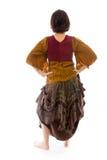 Вид сзади молодой женщины стоя с ее оружиями подбоченясь Стоковое фото RF