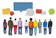 Вид сзади разнообразных людей и пустых пузырей речи Стоковые Фотографии RF