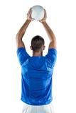 Вид сзади шарика игрока спорт бросая Стоковое Изображение RF