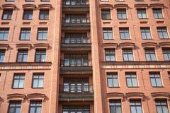 Вид спереди бушеля квартиры кирпичной стены современного Стоковые Изображения