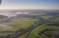 Вид с воздуха Амстердама северный Голландии от иллюминатора воздушных судн Стоковое Изображение