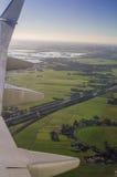 Вид с воздуха Амстердама северный Голландии от иллюминатора самолета Стоковое фото RF
