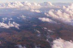 Вид с воздуха облаков осветил солнцем вечера над Флоридой, взглядом от воздушных судн во время полета Стоковые Изображения