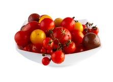 Виды томата желтого гороха, вишни и сливы изолированного на белизне Стоковое фото RF
