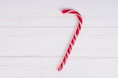 Вкусная тросточка конфеты на деревянной доске Стоковые Фото